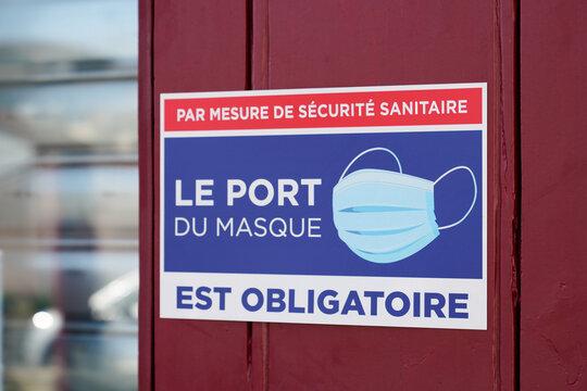port du masque obligatoire text french sign on wall store entrance against covid 19 coronavirus