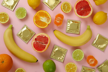 Obraz Sex concept with fruits and condoms on pink background - fototapety do salonu