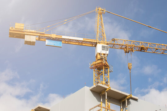 Construction crane. Construction site, high-rise buildings and development, partment house