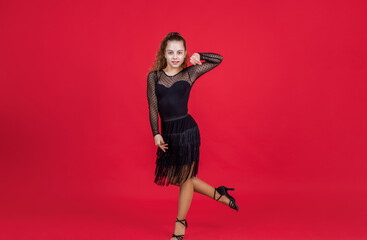 teen girl ballroom dancer. kid dancing in black dress. child in dance pose. professional slowfox and quickstep. waltz and tango. dancewear fashion clothes. dancing school