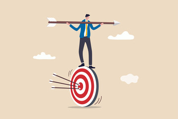 Result oriented business strategy or result driven, professionally set up and achieve business target concept, smart businessman balance and control rotating archery target with arrow hitting bullseye