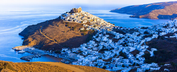 Greece scenery and traditional islands of Dodecanese. white houses of the Astypalea (Astipalaia) . View of Chora village and the sea over sunset