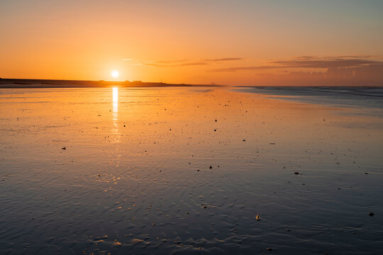 Sunrise over Camber Sands low tide in East Sussex, south east England