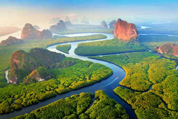 Aerial view of Phang Nga bay with mountains at sunrise in Thailand.