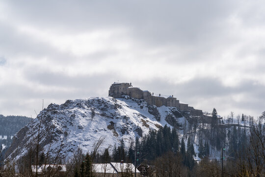 view of the Fort de Joux castle in the mountains of the French Jura in winter