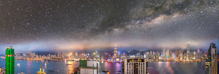 Amazing night panoramic view of Hong Kong skyline from Kowloon Tower with starry sky