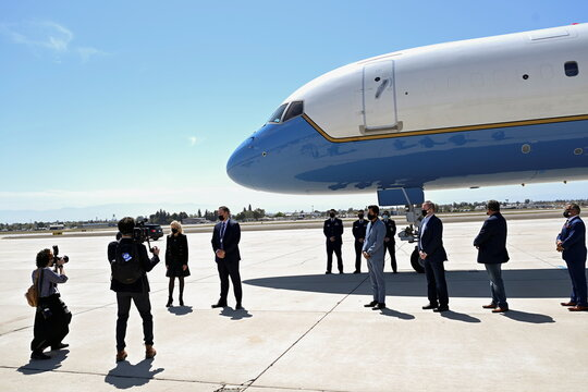 U.S. first lady Jill Biden poses for photos with volunteers as she boards a plane before departing from  Meadows Field Airport in Bakersfield