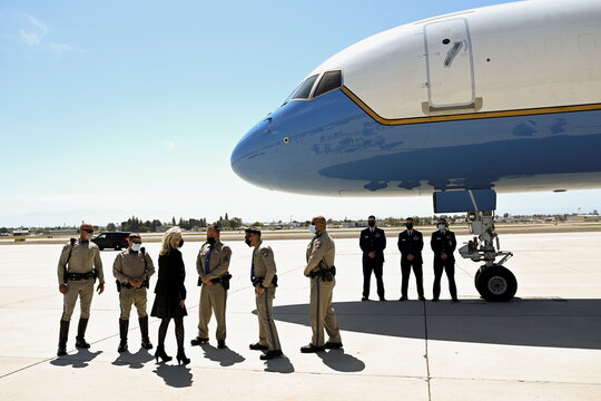 U.S. first lady Jill Biden speaks with members of the California Highway Patrol as she boards a plane before departing from Meadows Field Airport in Bakersfield