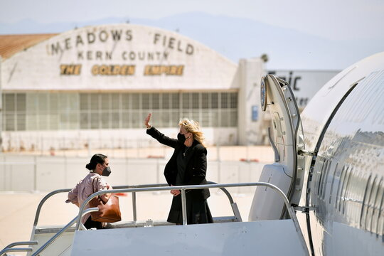 U.S. first lady Jill Biden waves as she boards a plane before departing from Meadows Field Airport in Bakersfield, California