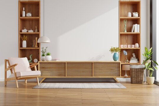 Cabinet for TV on the white wall in living room with armchair,minimal design.