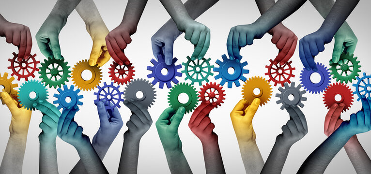 Team collaboration concept and connecting unity or teamwork idea as a business metaphor for joining a partnership as diverse people connected together as a work symbol for employee cooperation