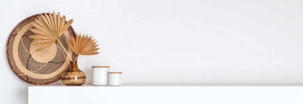 Coastal boho style interior decor on a white shelf