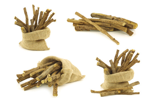 licorice root (sticks) and some in a burlap bag on white background
