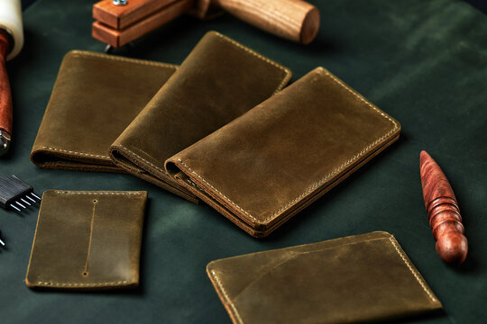 Set of handmade leather goods, key holder rings, wallet, purse, notepad, handbook. Handcrafted leather goods, close-up