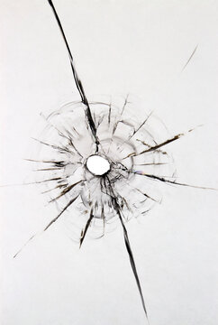 Texture of a damaged windshield ball. Cracked broken glass for design on a white background