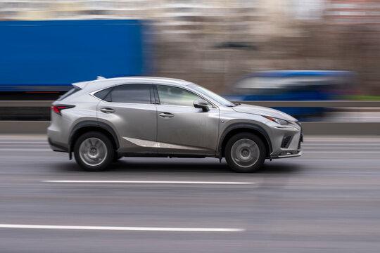 Ukraine, Kyiv - 18 March 2021: White Lexus NX car moving on the street. Editorial
