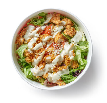 caesar salad with fried chicken meat