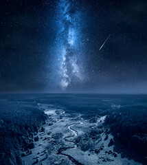 Milky way and falling stars over curvy river and swamps.