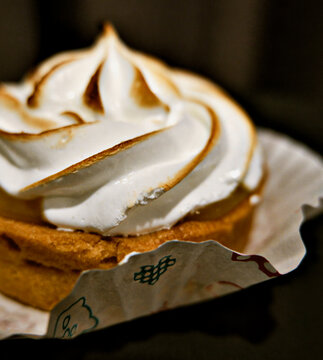 Front view of a lemon meringue tart serving on plate