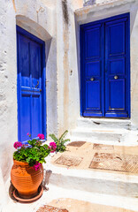 Old traditional white villages with colorful doors in Cyclades islands of Greece, Amorgos