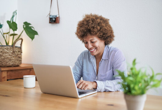 African senior woman working from home with computer laptop - Joyful elderly person and technology concept