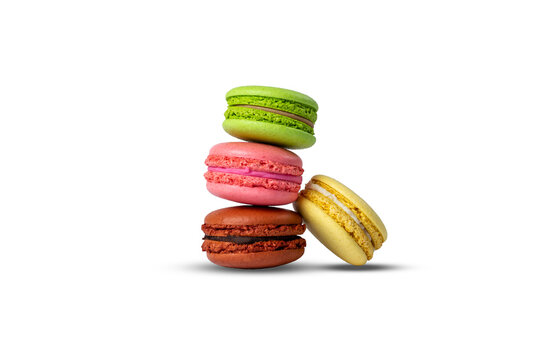 multicolored French pastry macarons isolated on white background. pyramid made from macarons.