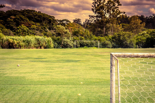 soccer field goal view, purple sky with clouds