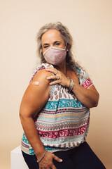 Senior woman getting a covid vaccine