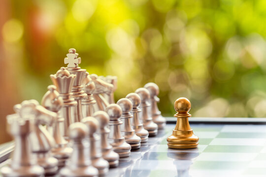 Chess board game on Blur green background, business concept