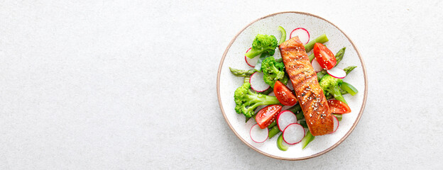 Salmon fish fillet grilled and vegetable salad with radish, tomato, green pepper, broccoli and...