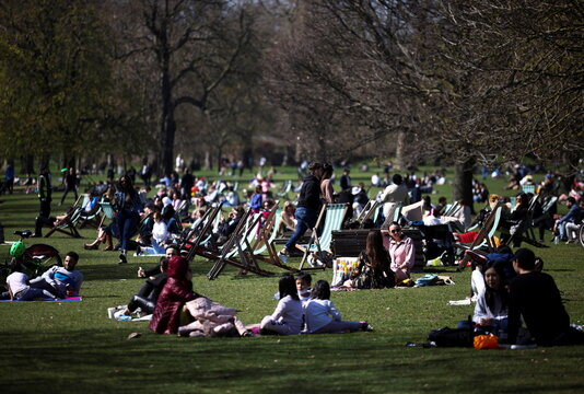 People relax during sunny weather in Hyde Park, amid the coronavirus disease (COVID-19) outbreak, in London