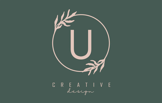 Letter U Logo with circle frame and pastel leaves design. Rounded vector illustration with letter U and pastel leaf.