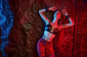 Attractive lady in bdsm handcuffs, sexual fantasy