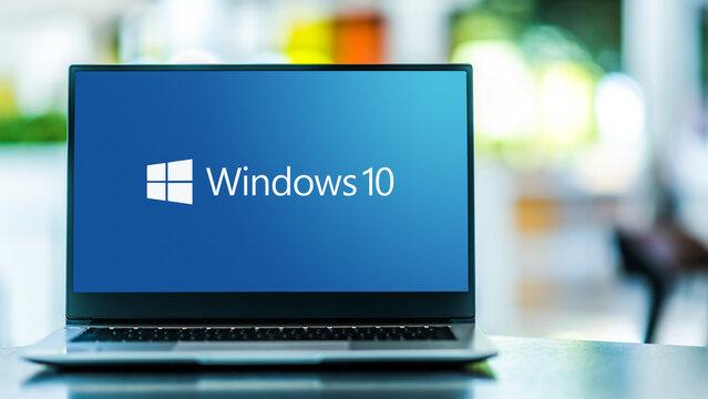 Laptop computer displaying logo of Windows 10