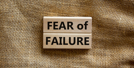 Fear of failure symbol. Wooden blocks with words 'fear of failure'. Beautiful canvas background, copy space. Business, fear of failure concept.