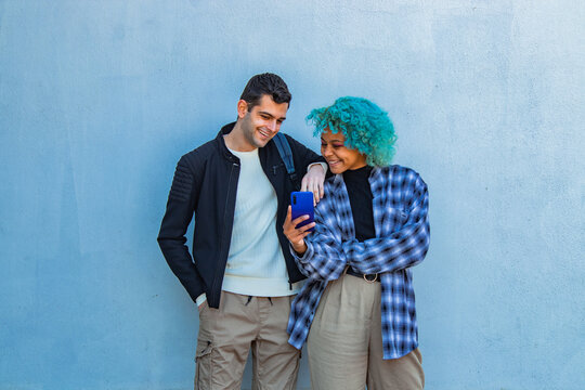 couple with mobile phone on the wall