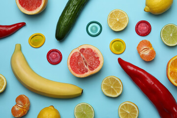 Obraz Sex concept with fruits and condoms on blue background - fototapety do salonu