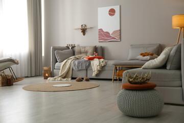 Fototapeta Spacious living room interior with comfortable sofa obraz