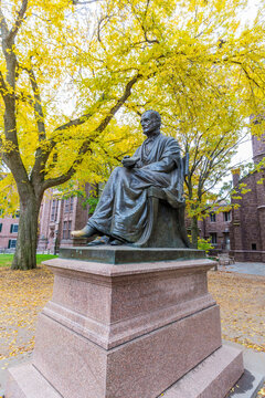 Theodore Dwight Woolsey statue and Phelps Hall on campus of Yale University on a sunny afternoon. Yale University is a Private Ivy League University in USA