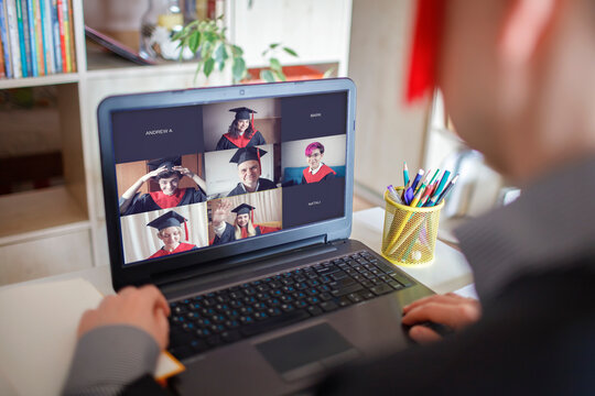 Virtual graduation and convocation ceremony. Laptop screen with happy students wearing graduation gown and cap receiving congratulation from professor during online video call, distant education