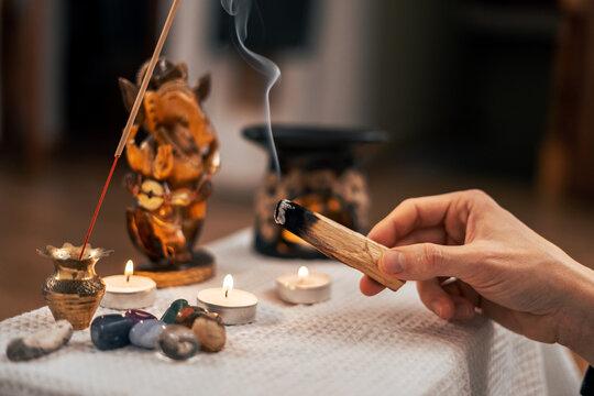 Palasata's wand slowly smoulders with smoke near the meditation altar