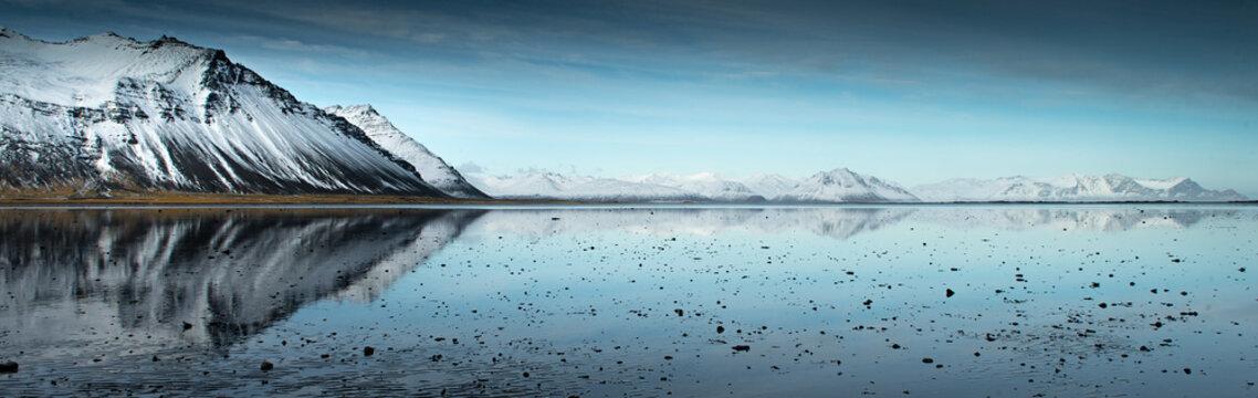 Lake reflecting mountains in Iceland