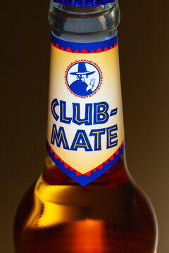 Club-Mate bottle on the glass table.