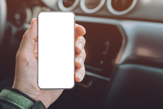 Mobile smart phone device in male hand, mock up with blank white screen