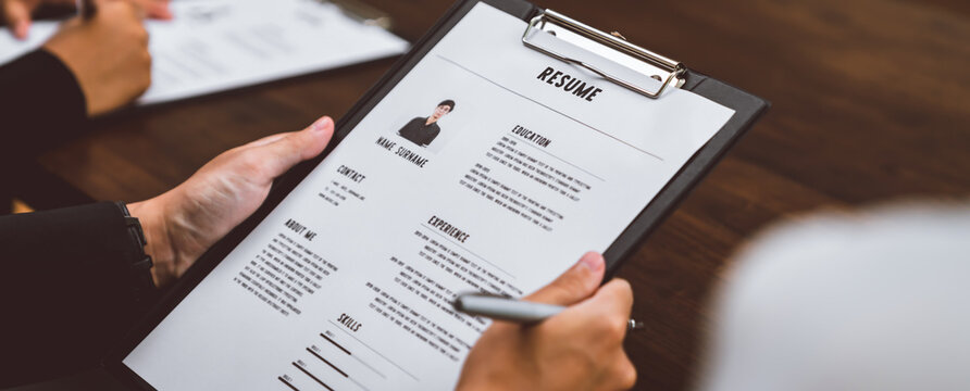 Businesswoman submits resume employer to review job application information on the desk, presents the ability for the company to agree with the position of the job.