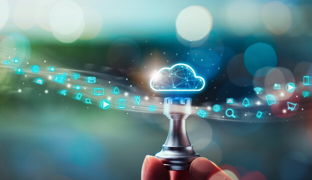 Cloud computing technology concept, Hand holding chess with upload data on internet storage, social media icon on digital screen innovation and technology.