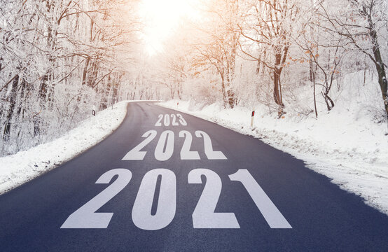 Empty road in forest in winter with 2021 2022 and 2023 text