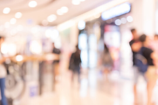 Abstract defocused or blurred background of the shopping mall with nice department store interior. which including of people and shop store.