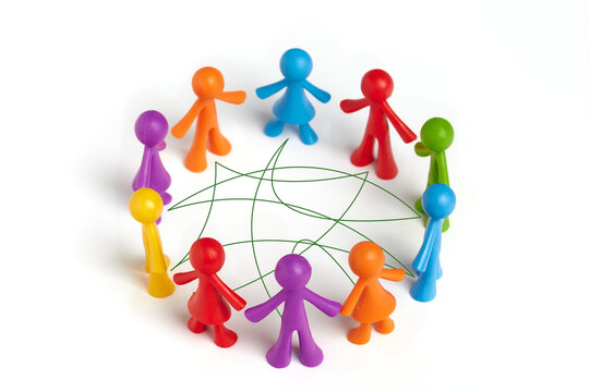 . Group of toy people connected by lines isolated on white background. The concept of collaborative problem solving, diplomacy, social connection, teamwork,