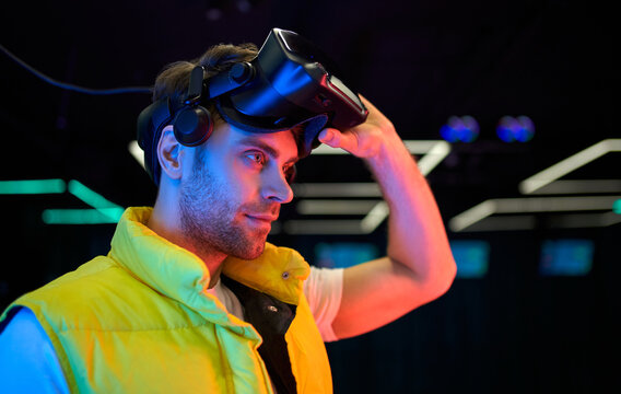 Young man in virtual reality space